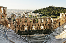 View of ancient Roman Theatre in Athens. City is in the background.