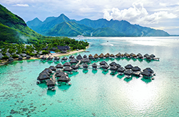 French Polynesia coastal view with clear waters and mountains in background