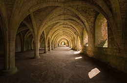 Fountains Abbey Hallway with arches and windows