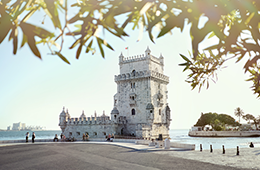 Belem Tower in Portual on coast with tourists