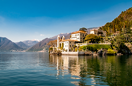 Lanscape of italian lake with lakeside home on the mountains