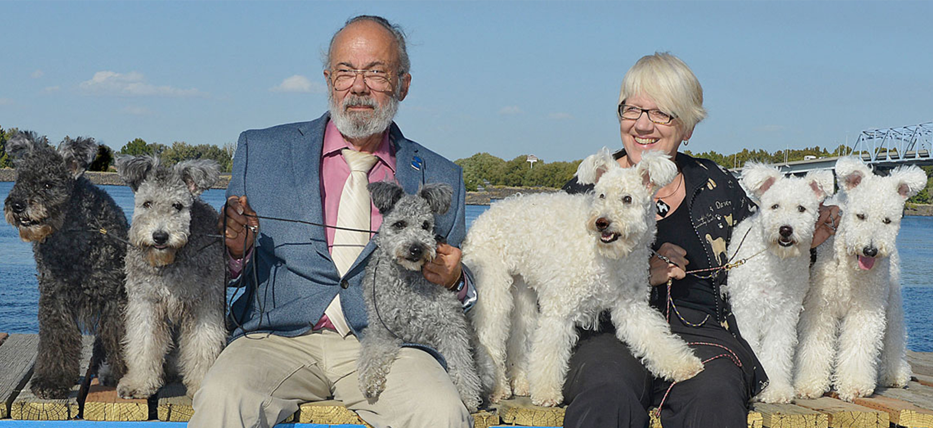 Tom and Chris Levy with pups
